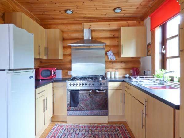 A kitchen or kitchenette at Tamaura Lodge