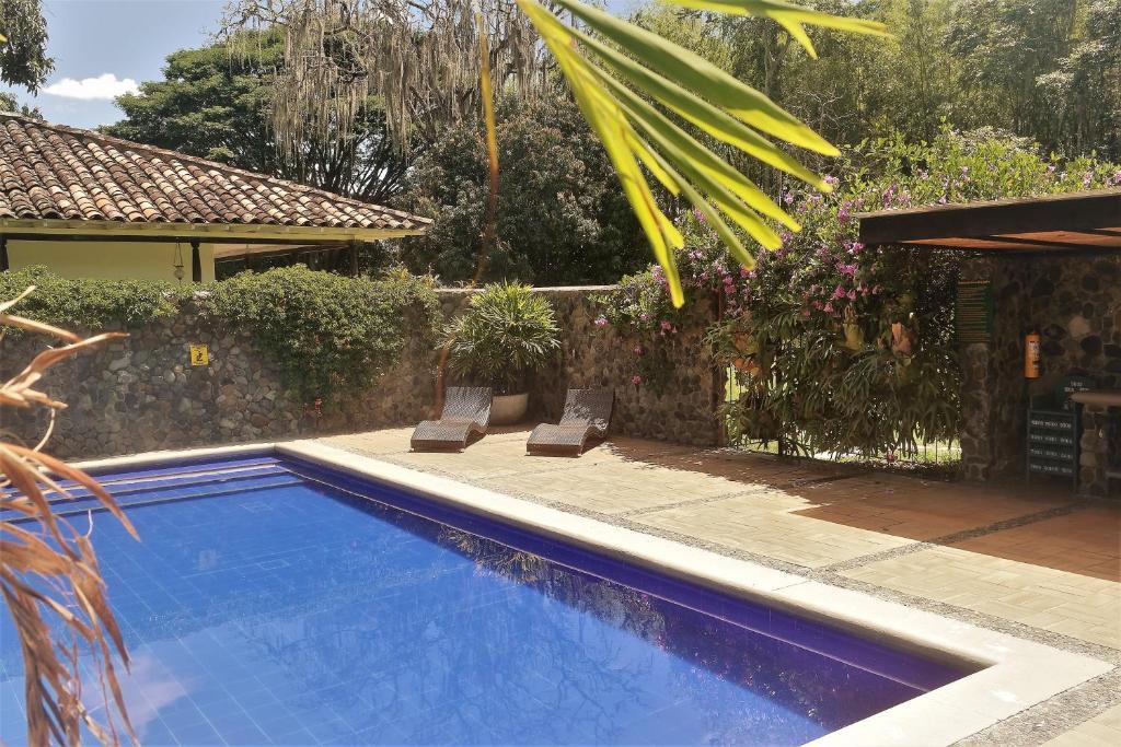 The swimming pool at or near Hacienda Castilla