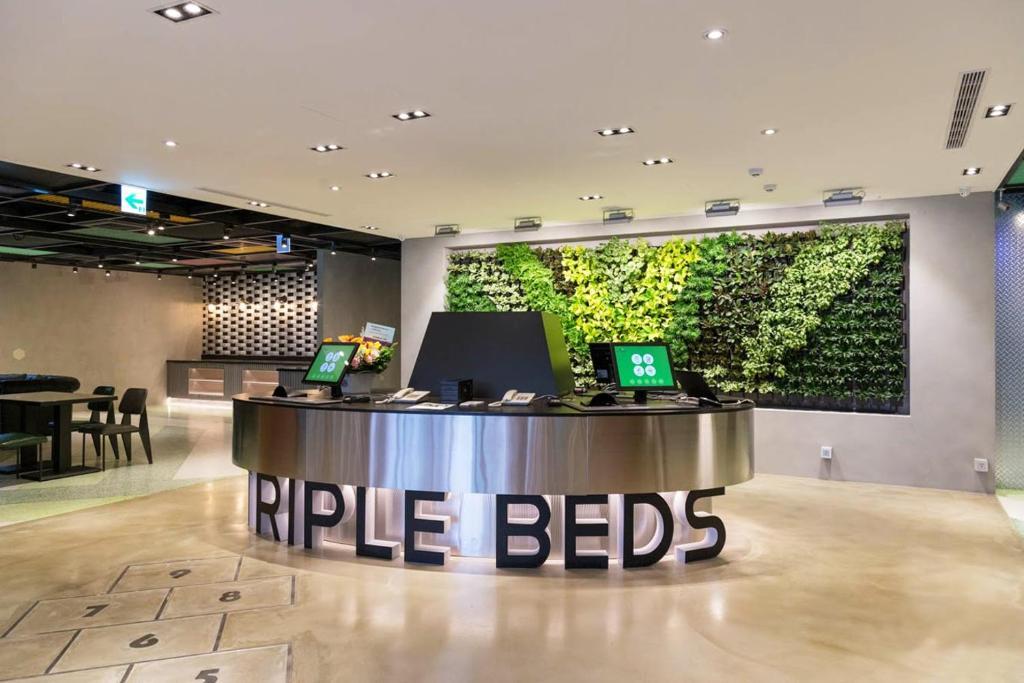 ล็อบบี้หรือแผนกต้อนรับของ Green World Triple Beds