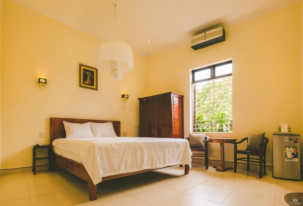 A bed or beds in a room at An By Ivy Homestay