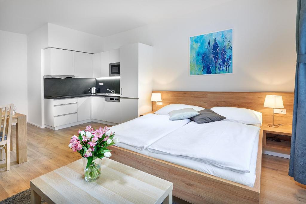 A bed or beds in a room at DownTown Suites Belohorska
