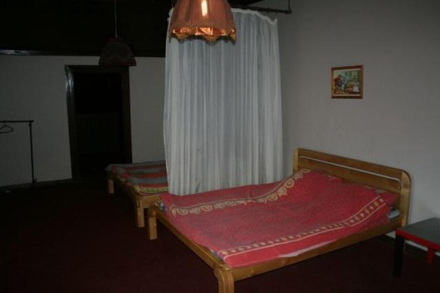A bed or beds in a room at Lesnoy Dom Mehzavod