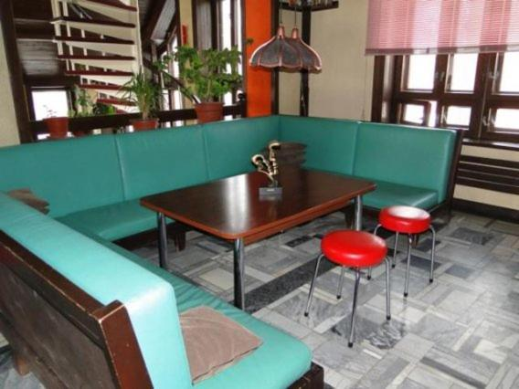 The lounge or bar area at Lesnoy Dom Mehzavod