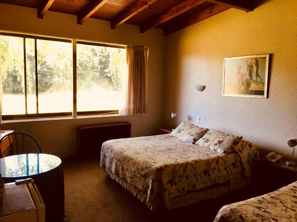 Cama o camas de una habitación en Hotel Salto Del Laja