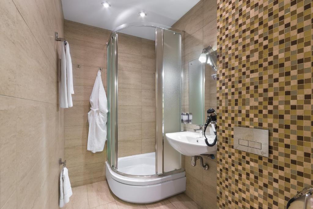 Ванная комната в Отель Дегас Лайт