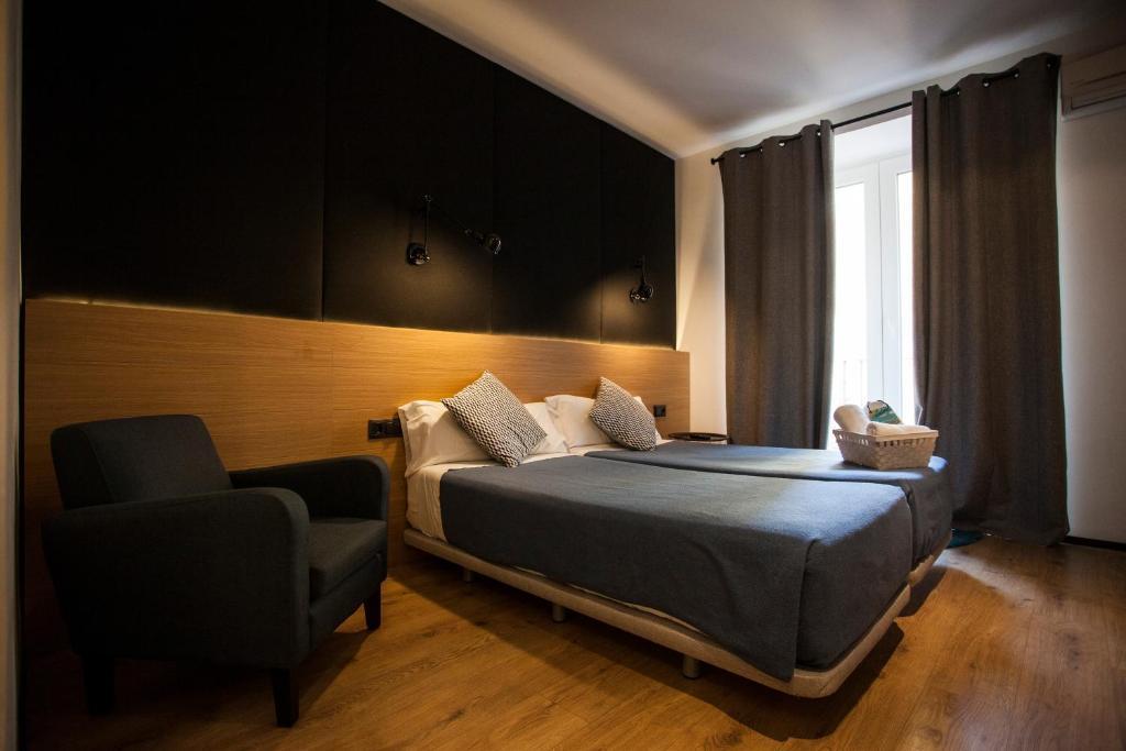 Cama o camas de una habitación en CC Malasaña