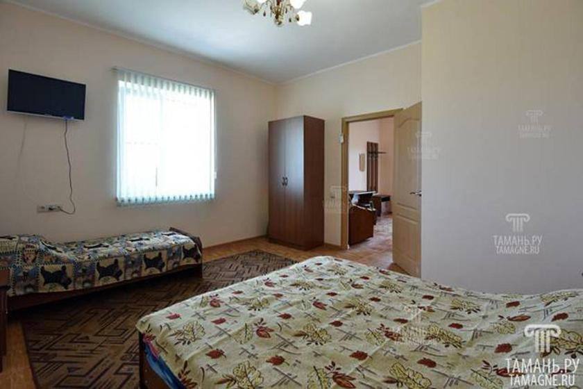 A bed or beds in a room at «Домашний уют»