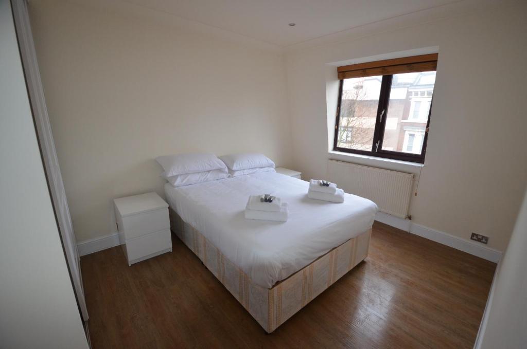 Letto o letti in una camera di Central Comfort Apartments