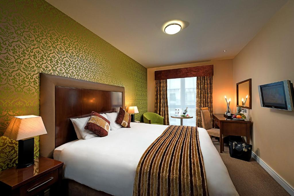 Vuode tai vuoteita majoituspaikassa George Limerick Hotel