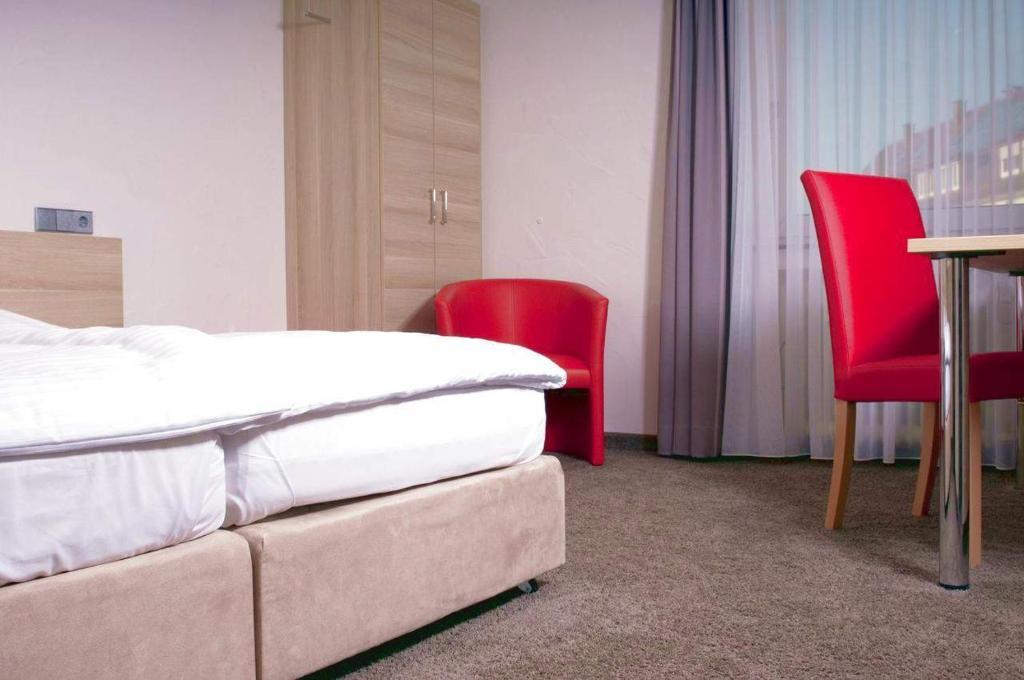 Giường trong phòng chung tại Hotel Wanner