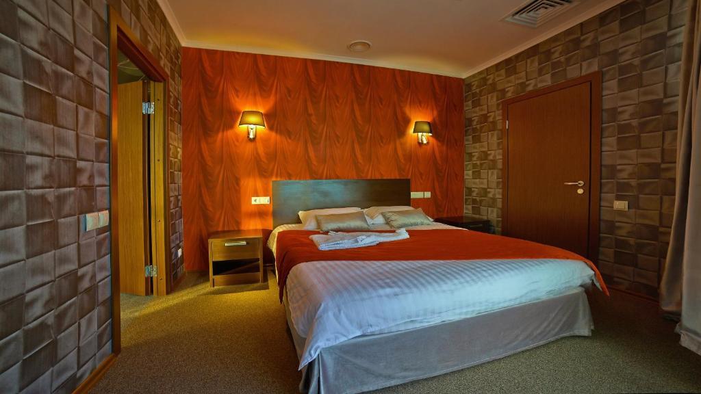 Кровать или кровати в номере Aer Hotel