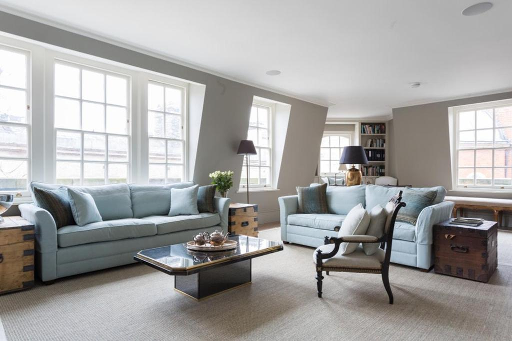 A seating area at Broad Court III by Onefinestay
