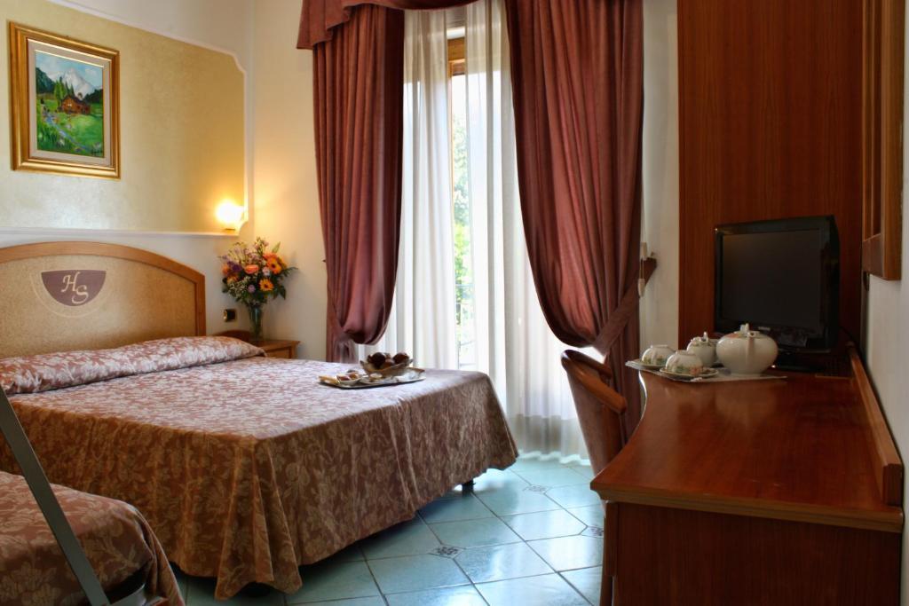 Letto o letti in una camera di Hotel Savoia