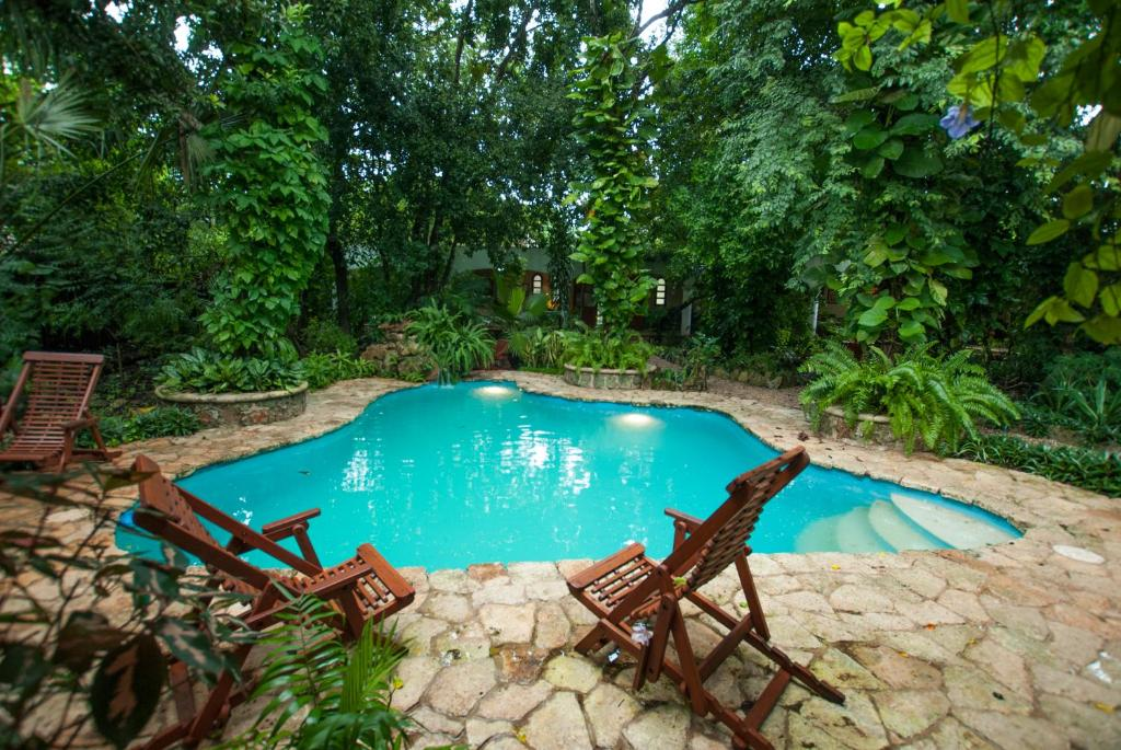 The swimming pool at or near Casa Quetzal Boutique Hotel
