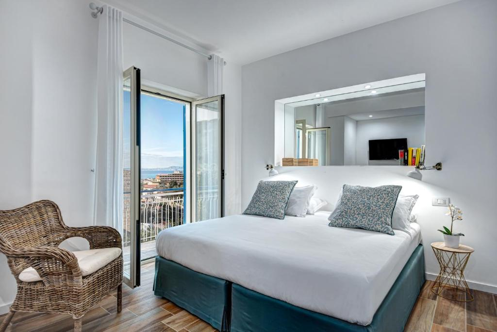 A bed or beds in a room at Caruso 5