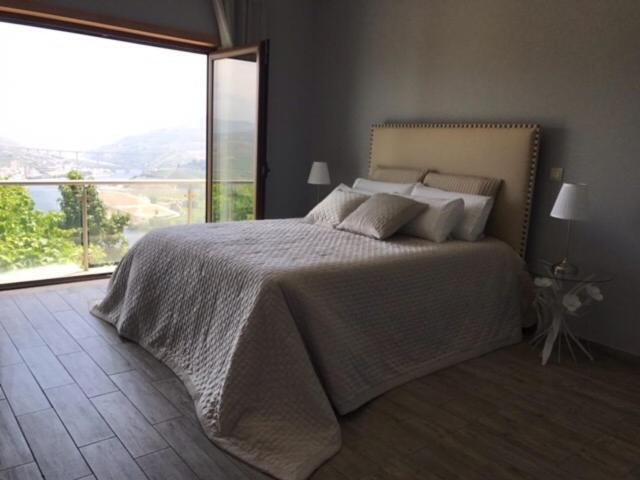 A bed or beds in a room at Quinta Pecêga