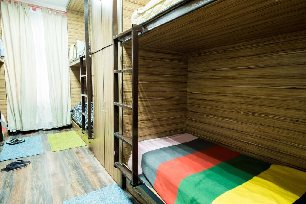 Кровать или кровати в номере Хостел Радужный
