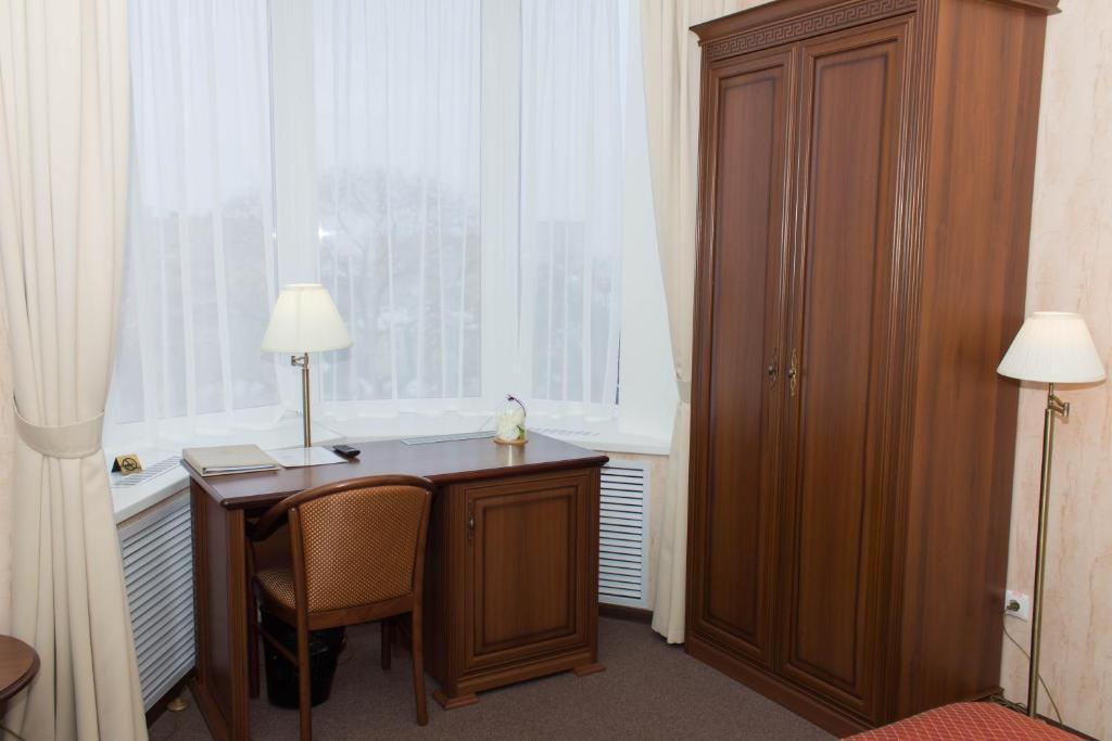 Телевизор и/или развлекательный центр в Отель Минин на улице Пожарского