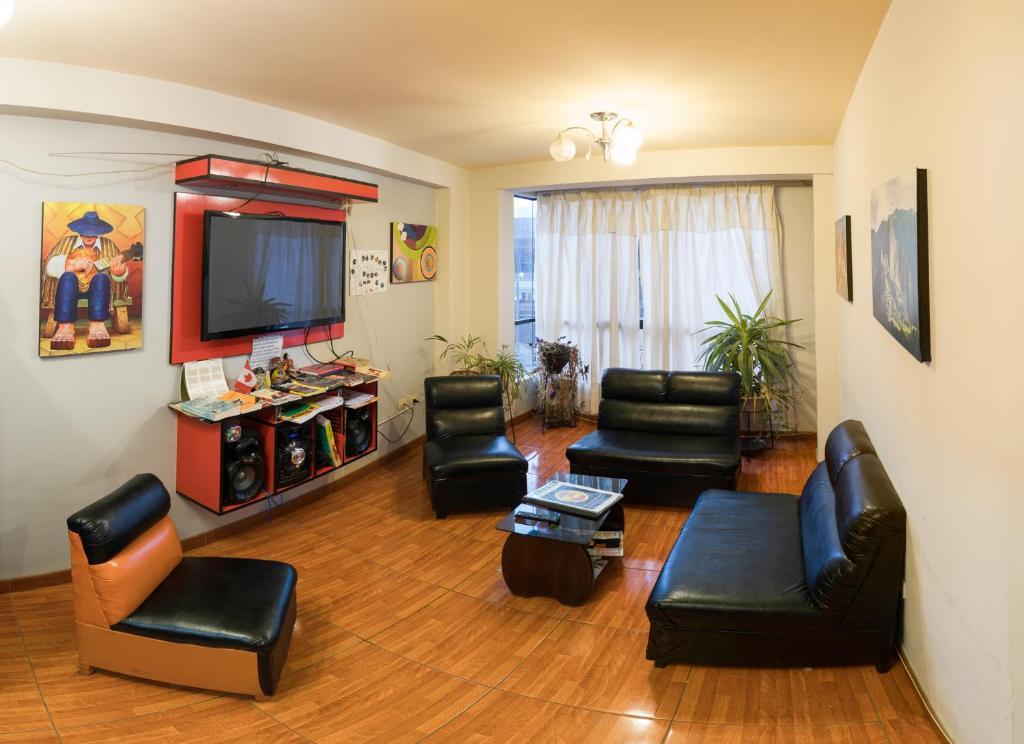 Zona de estar de Carlos Guest House Cusco 2