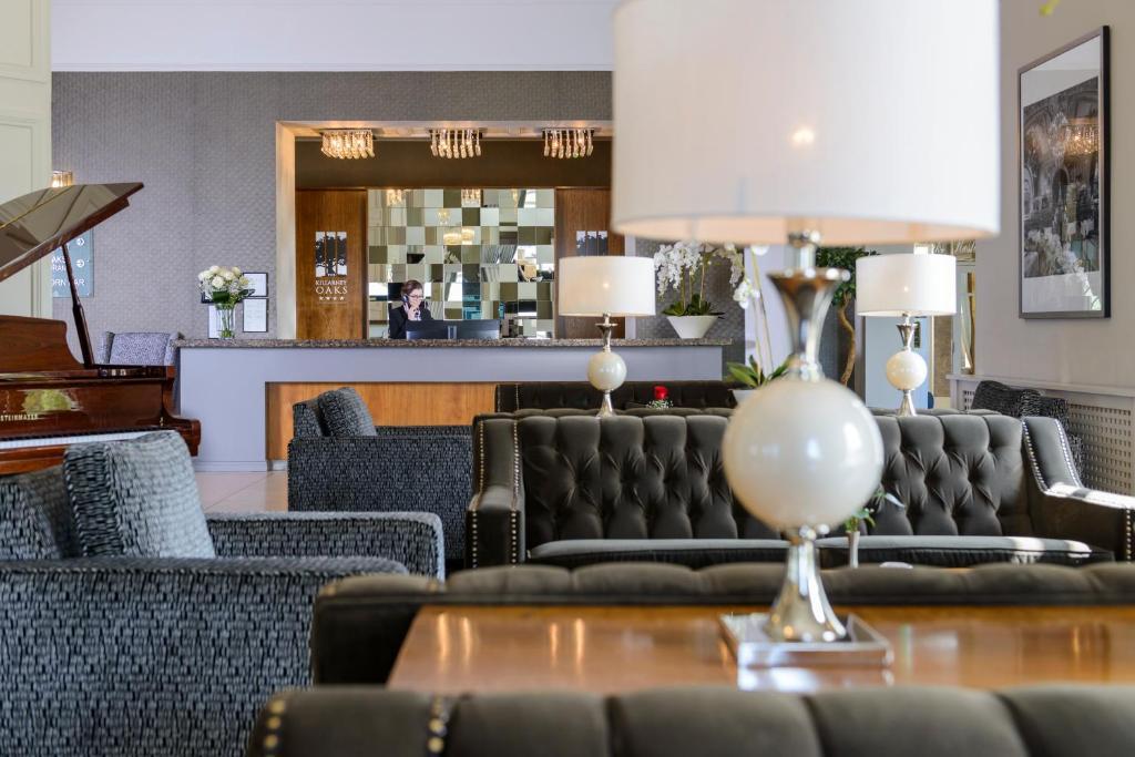 O lounge ou bar de Killarney Oaks Hotel