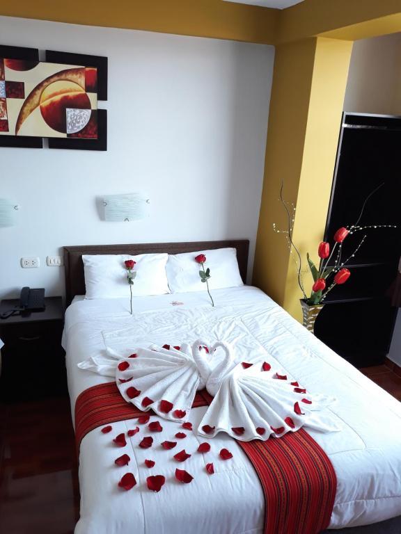 Cama o camas de una habitación en Pumas Cusco Hotel