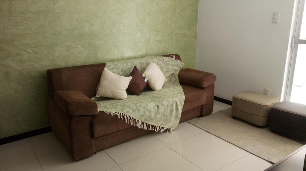 A seating area at Apartamento Mobiliado - Aracaju