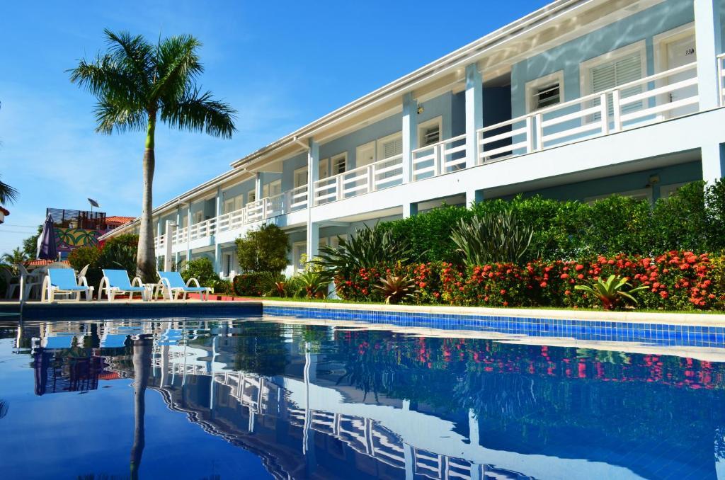 A piscina localizada em Pousada Azul da Cor do Mar ou nos arredores