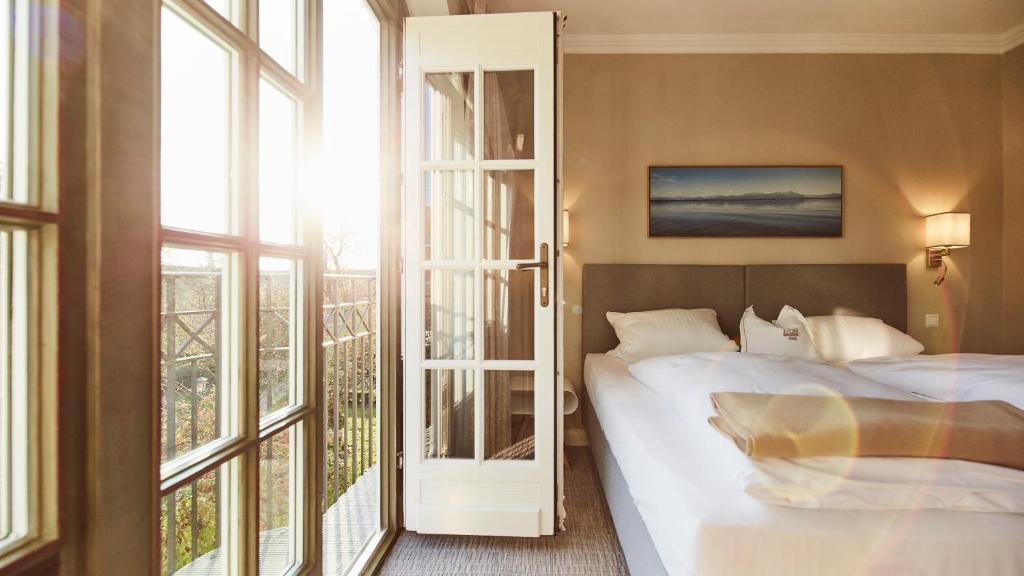 Ein Bett oder Betten in einem Zimmer der Unterkunft Hotel Gutsgasthof Stangl