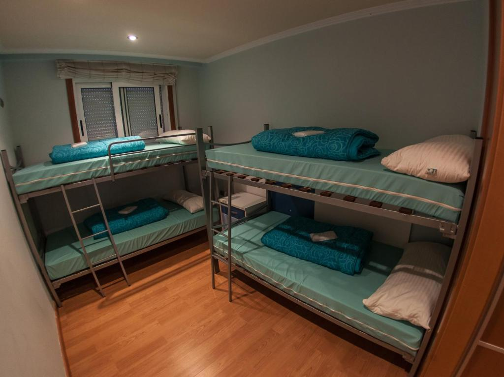 A bunk bed or bunk beds in a room at Albergue Orois