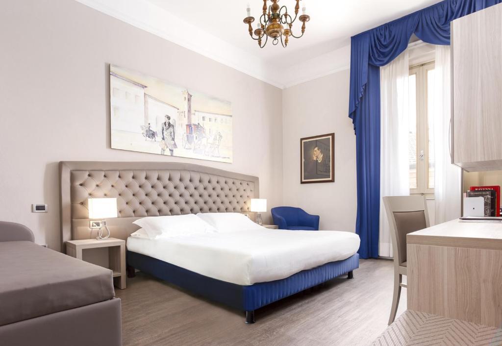 Letto o letti in una camera di Hotel Ala D'Oro