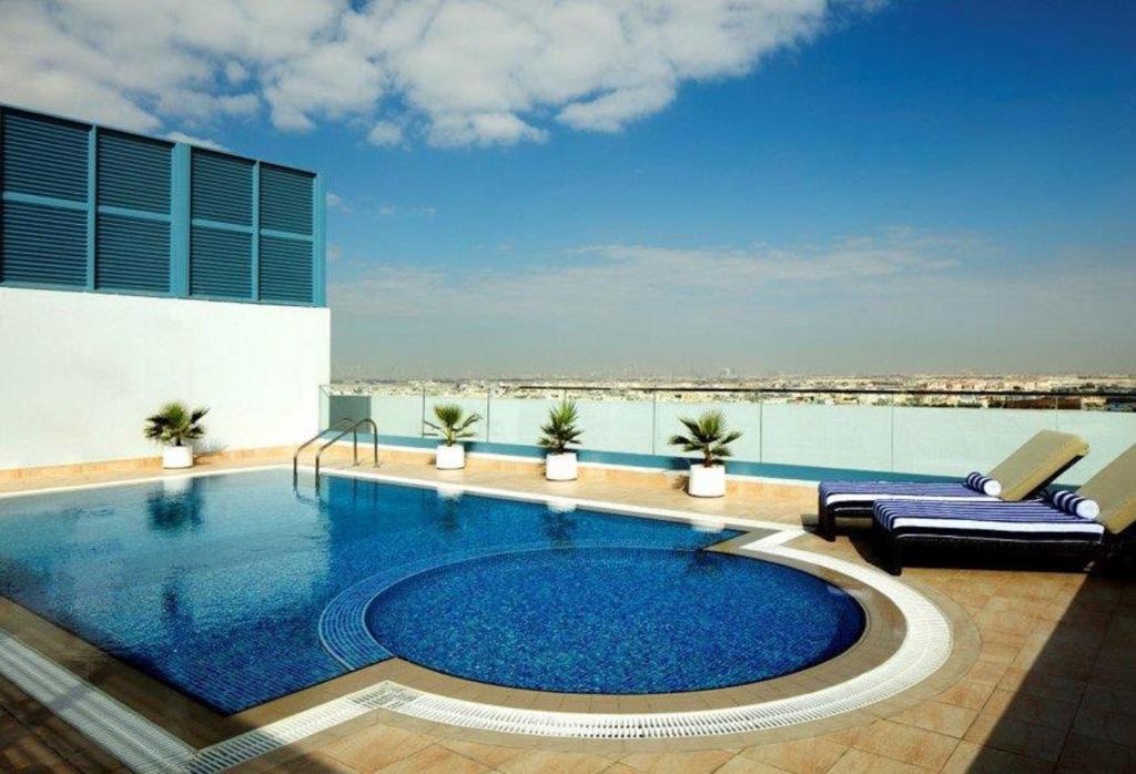 Pleasant Radisson Blu Hotel Apartment Dubai Uae Booking Com Download Free Architecture Designs Viewormadebymaigaardcom