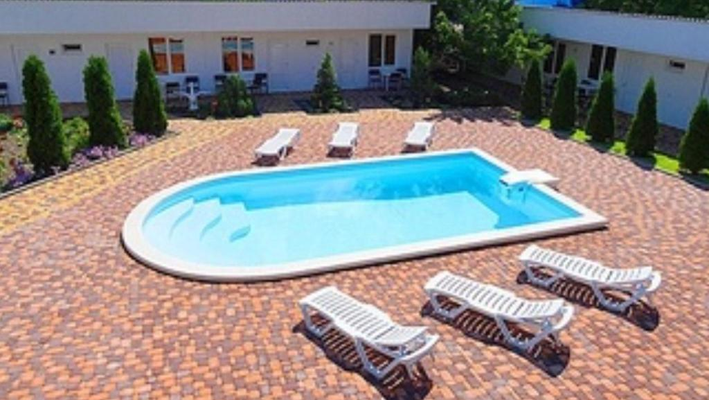 A view of the pool at Guest House Belaya Lebed or nearby