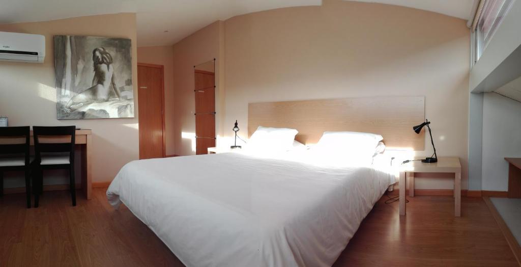 Ein Bett oder Betten in einem Zimmer der Unterkunft Penthouse - Low Cost
