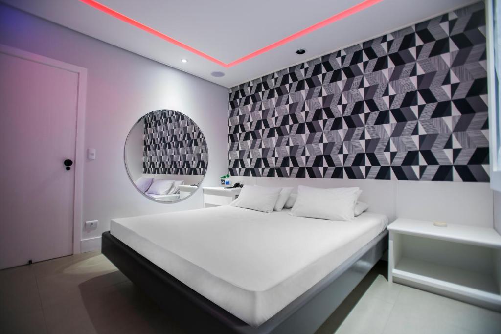 Säng eller sängar i ett rum på Rivieras Motel (Adult Only)