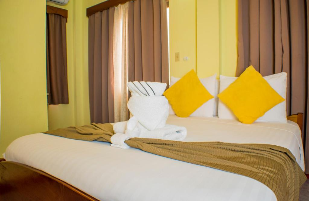 A bed or beds in a room at Belcove Hotel & Guesthouse
