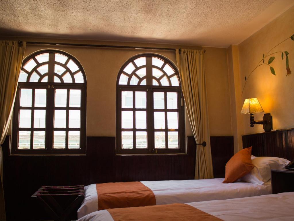 Cama o camas de una habitación en Cruz Loma Hotel