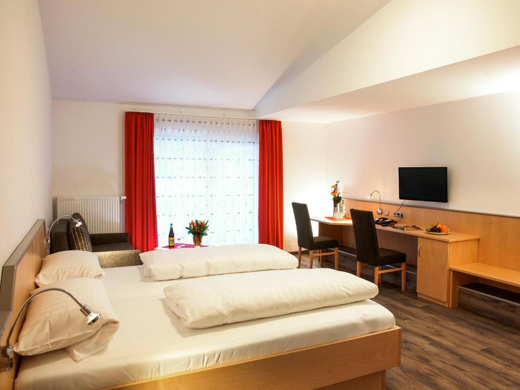 Ein Bett oder Betten in einem Zimmer der Unterkunft Hotel Gasthof zum Biber