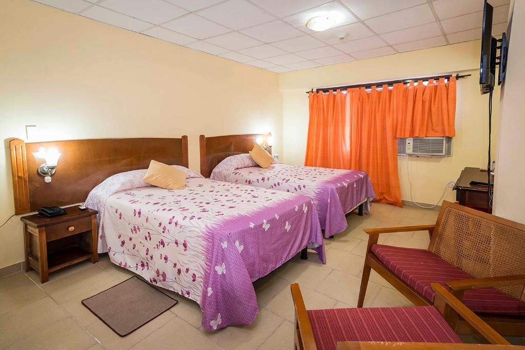 Letto o letti in una camera di Hotel Bella Habana
