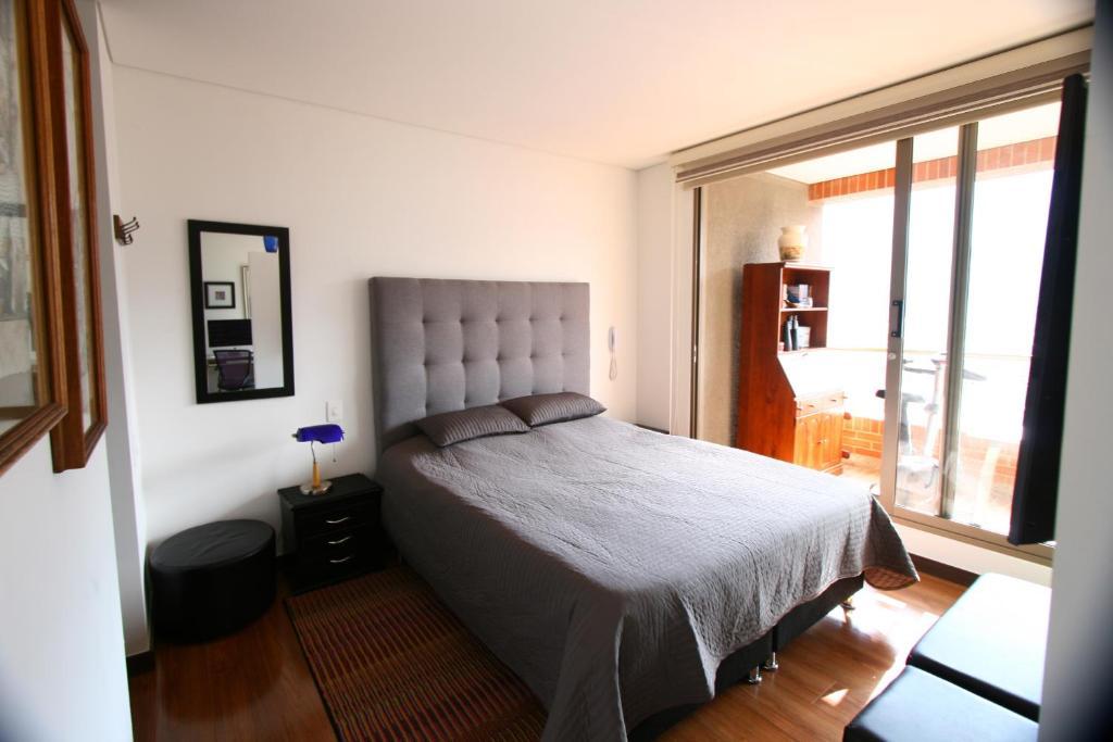 Vuode tai vuoteita majoituspaikassa Apartamento Alto Bogotá