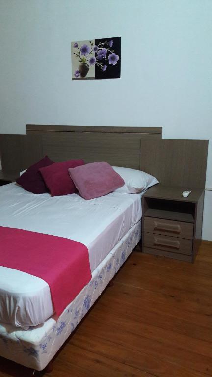 Una cama o camas en una habitación de Apartamento Duplex Iguazu Falls