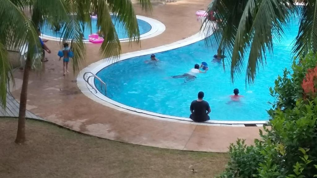 The swimming pool at or close to Rose Condo@ Cocobay Beach Resort