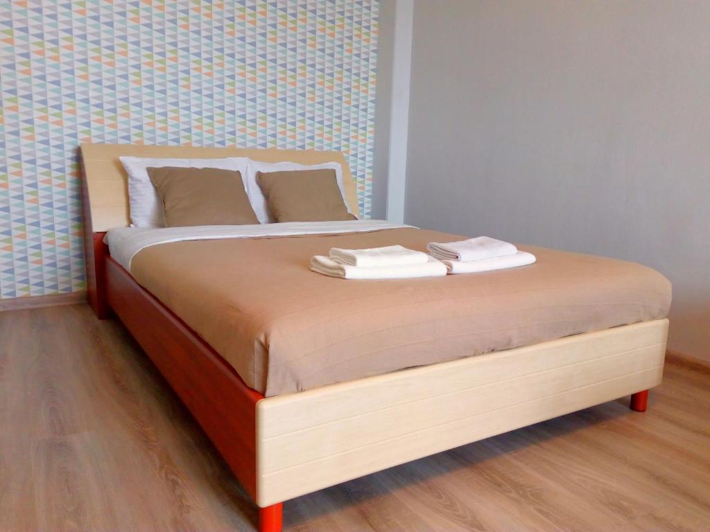 Кровать или кровати в номере Apartment on Sovetskaya 21