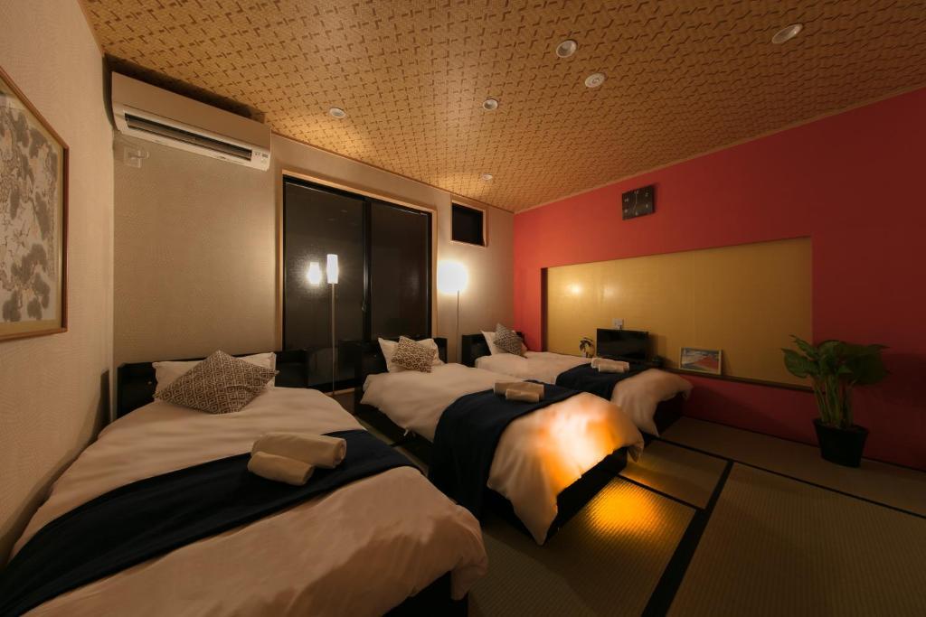 ゲストハウス 東九条柳下町にあるベッド