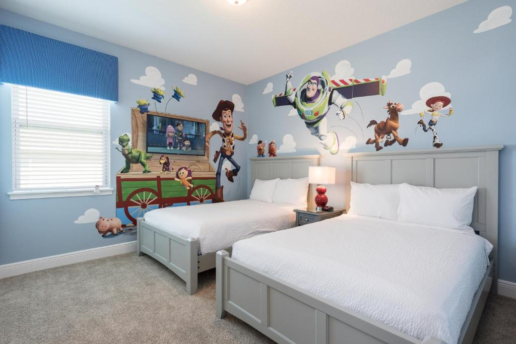 A bed or beds in a room at Encore Resort 2106 8 Bedroom Water Park