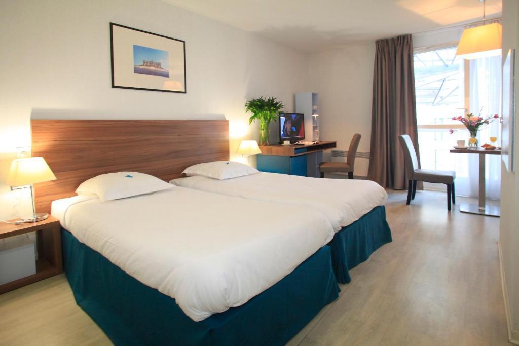 Un ou plusieurs lits dans un hébergement de l'établissement Odalys City Marseille Canebière