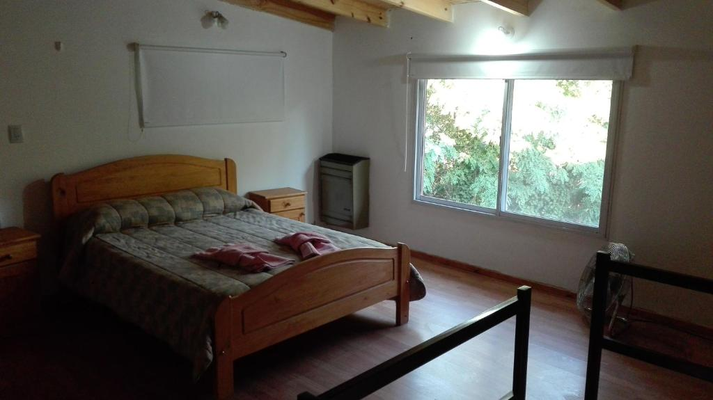 Una cama o camas en una habitación de Departamentos Ventana
