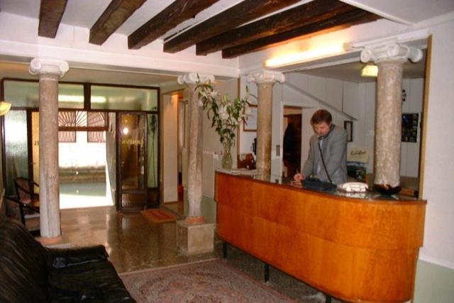 The lobby or reception area at Hotel Caneva