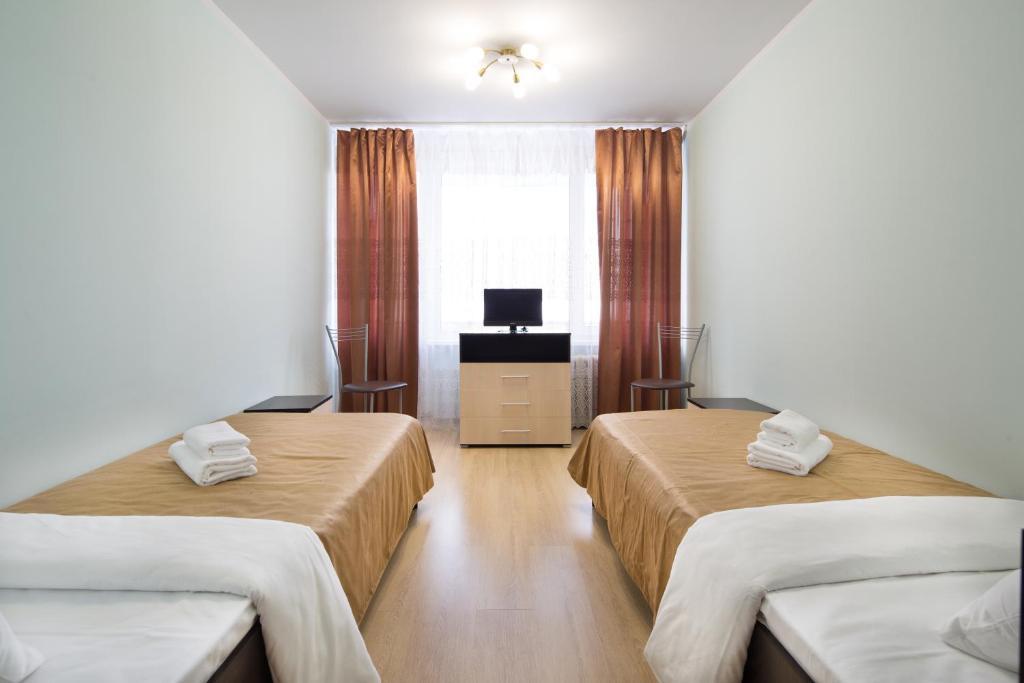Кровать или кровати в номере Hostel RAMN