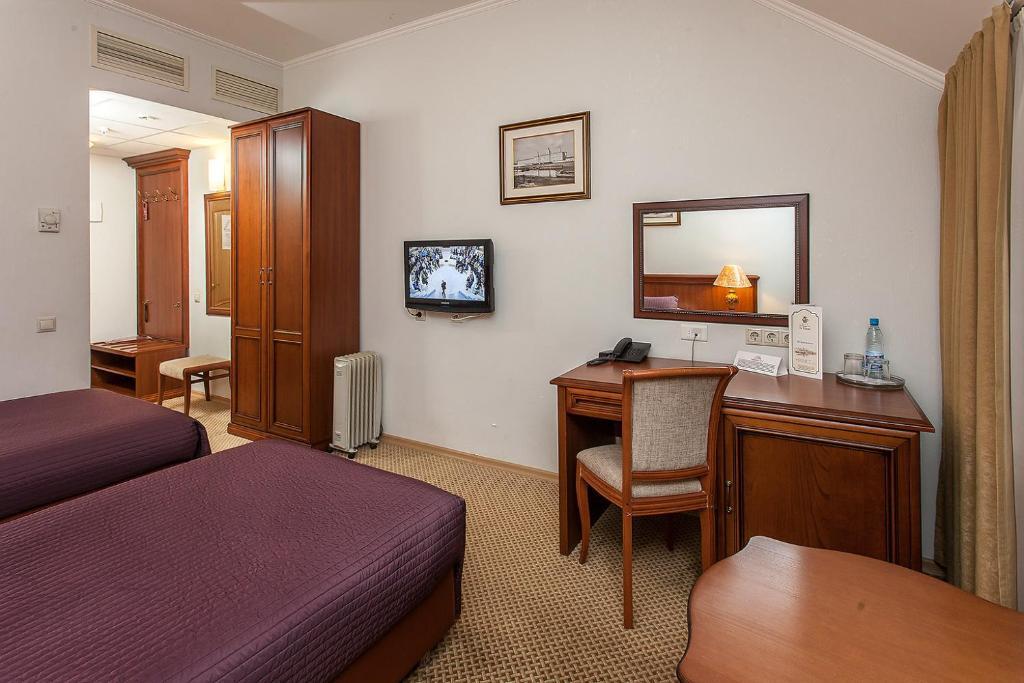 Телевизор и/или развлекательный центр в AZIMUT Hotel Yaroslavl
