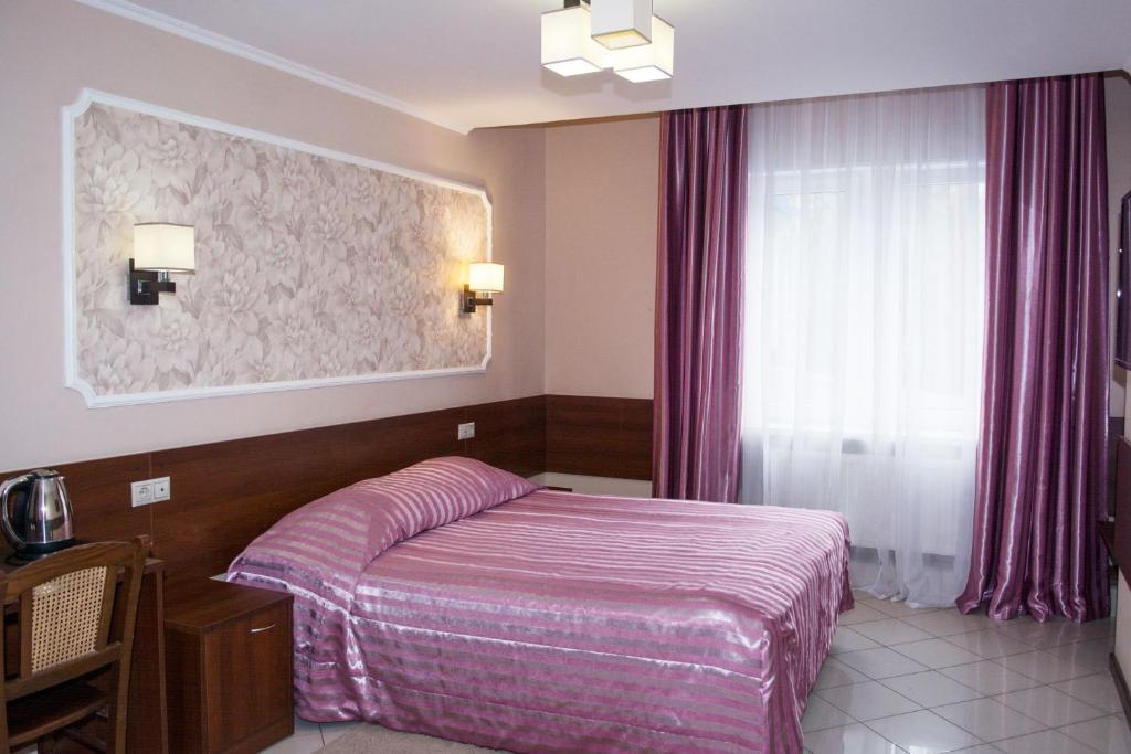 A bed or beds in a room at Green Park